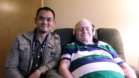Barber School student Gary Su with one of the Baptist Housing clients he worked with during the Music and Memories project.