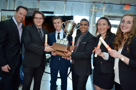 Argus Properties Vice-President of Finance and Accounting Justin Bierwirth and Management students Kyle Patan, Cameron Mahler, Gopal Patel, Jenel McKenney and Audrey Kaake hold the Argus Cup after winning the 2016 Live Case Challenge.