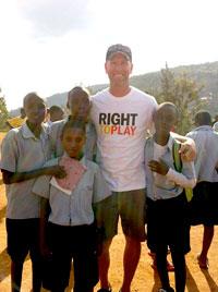 Assist. Prof. Stephen Berg with school children in Rwanda.