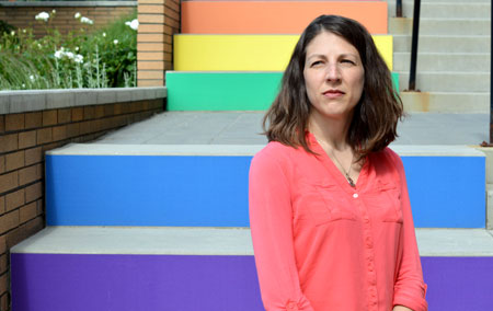 Susan Holtzman stands in front of the 'rainbow staircase' of inclusion.