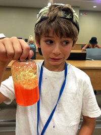 A young camper learns the science behind lava lamps at last year's Geering Up program.
