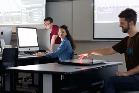 FCCS and Barber School Instructor Miles Thorogood (right) shows students some of the technology that will be used in the new Bachelor of Media Studies program.