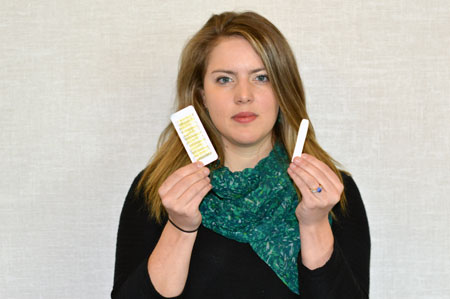 Assistant Professor Heather Gainforth holds a nicotine inhaler, a popular tool with people trying to quit smoking.