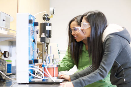 Engineering students Sneha Philip and Saveena Kahlon, right, conduct lab work at UBC's Okanagan campus. The School of Engineering hosts its inaugural open house on November 19.
