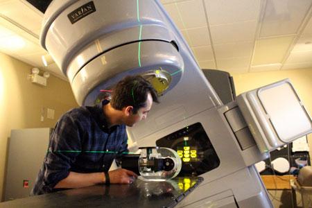 UBC adjunct physics prof. Tony Teke running tests on a linear accelerator.
