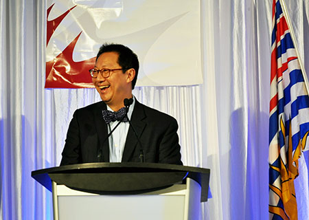 UBC President Santa Ono shares a laugh with the audience during the Valley First/UBC Okanagan Athletics Scholarship Breakfast Friday morning.