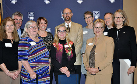 Deborah Buszard, deputy vice-chancellor and principal of UBC Okanagan (right), and Lisa Castle, vice-president UBC Human Resources (third from right), congratulate (from left) Carol Boyd, Greg Wetterstrand, Linda Allan, Kim Filice, Mary Ann Murphy, Robert Belton, Nina Langton and Donovan Hare.