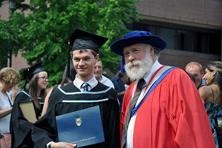 Barber School student Raphael Nowak (left) poses with his mentor Ian Walker, professor of biology.