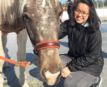 UBC International student Chin-Wen Chong from Singapore spends some quality time with Dobey, a 2.5-year-old rescue horse from the Cheeky Ranch in Pemberton. HorseSense is one of 64 Thrive events taking place this Week.