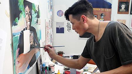 Benjamin Arcega working in his fourth-year studio, 2017 graduate of UBC Okanagan's Bachelor of Fine Arts program.