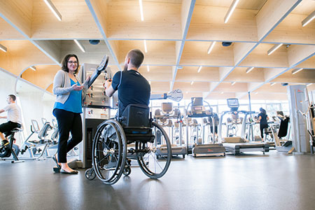 UBC Okanagan Professor Kathleen Martin Ginis chats about physical activity with tennis player and UBC student Rob Shaw.