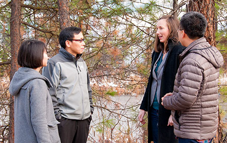 UBC researchers (from left to right) Abby Yang, Associate Professor Adam Wei, Krysta Giles-Hansen and Qiang Li discuss the role forest vegetation plays while monitoring water resources.