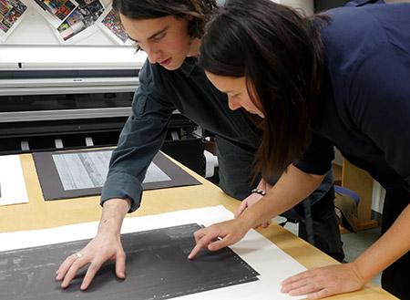 UBC instructor Katherine Pickering reviews Bachelor of Fine Arts student Matthew Glenn's portfolio.