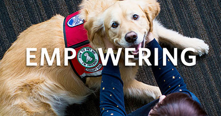 O in UBC campaign image featuring happy dog