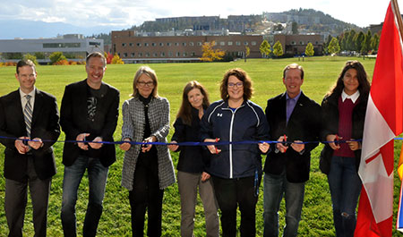 Stephen Fuhr, Member of Parliament for Kelowna-Lake Country (second from left) and UBC Okanagan Deputy Vice-Chancellor and Principal Deborah Buszard (third from left) stand with UBC students and staff at the opening of the Commons Field.