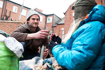 A homeless woman receiving help.