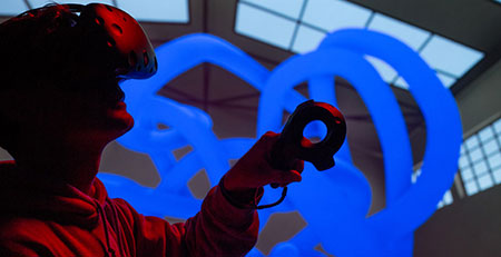 Photo os a student using virtual reality equipment