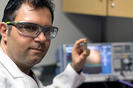 Mohammad Zarifi, assistant professor of engineering, shows his small biosensor that can be used to provides health care practitioners with a real-time diagnosis of a bacterial infection.