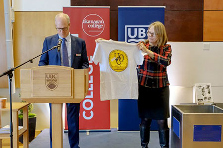 Okanagan College President Jim Hamilton and UBC Okanagan's Deputy Vice-Chancellor Deborah Buszard remove items from Okanagan University College time capsule.