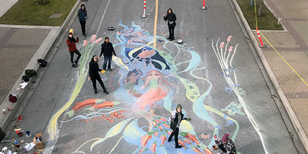 An overhead view of the new mural on University Way created by BFA students.