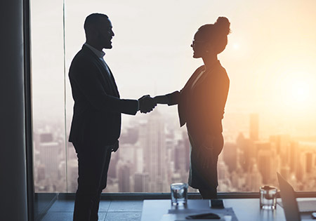 Stock photo of a woman and man in a business setting