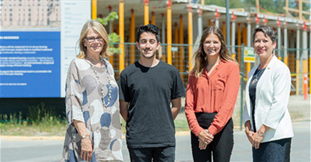At the construction site, from left, UBC Deputy Vice-Chancellor Deborah Buszard, UBC Students' Union Okanagan Vice-President Campus Life Ali Poostizadeh and Vice-President Services Taylor Dotto joined the Hon. Melanie Mark, BC Minister of Advanced Education, Skills and Training.