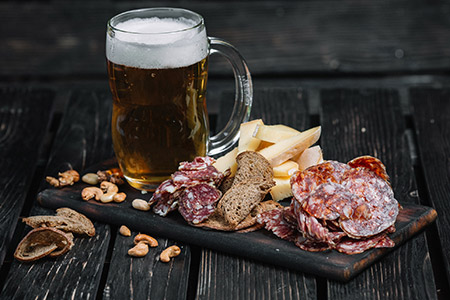 Image of a beer and charcuterie board