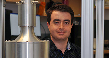 Doctoral student Sajjad Mohammadnejad with a mixed gas burner used by engineering researchers in the Combustion for Propulsion and Power Laboratory at UBC Okanagan.