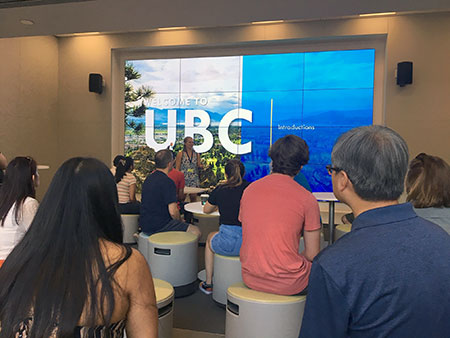 Prospective students and families gather in the new starting location of UBC's Okanagan campus tours, The Commons' Engagement Theatre.