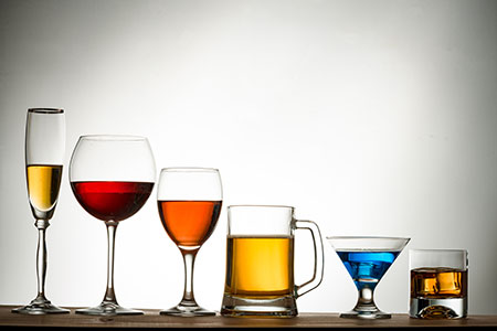 A stock photo of a lineup of different alchoholic drinks