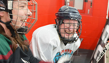 Student Experience Office Senior Manager Phil Bond, right, enjoys some comradery during an informal hockey game at the Ultimate 3x3 rink in West Kelowna.