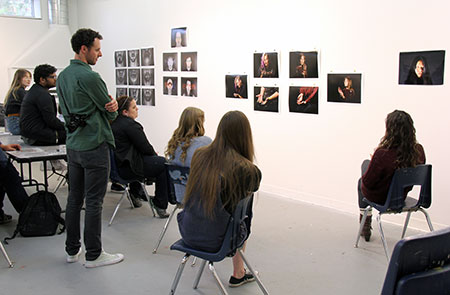 Photography Instructor Andreas Rutkauskas leading a discussion about student photography projects.