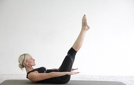 An image of a woman doing clinical Pilates