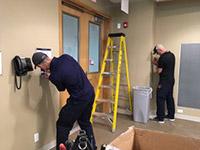 Maintenance Technicians Jeff Vogt and Matt Litzenberger carrying out essential electrical work at UBCO.
