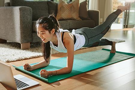 A woman doing virtual yoga