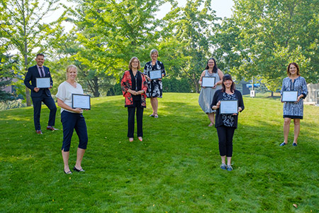 Some of the Staff Awards of Excellence recipients collect their certificates from Deputy Vice Chancellor and Pricipal Lesley Cormack. From left to right: Philipp Reichert, Linda Drew, Lesley Cormack, Colleen DuManoir, Jenny Janok, Alanna Vernon and Nancy Adams.