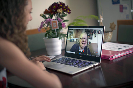 Naomi Mison, who is hosting an event to discuss virtual solutions to support loved ones during COVID-19, has a conversation with her mother on Skype.
