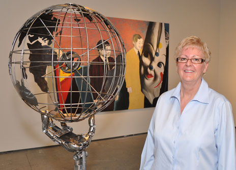 "Curator Susan Belton views an untitled 2007 steel sculpture symbolizing global citizenship by Vernon artist Cory Fuhr, part of the ""Male Perspective"" art exhibit at UBC's Fina gallery."
